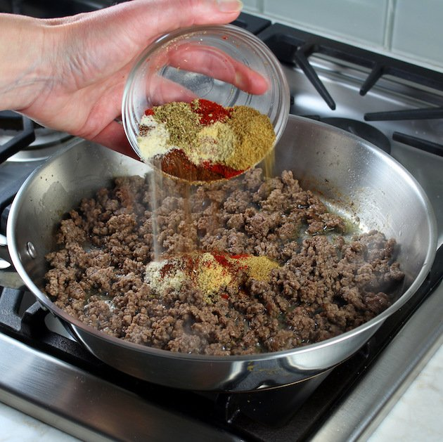 Adding Seasonings to Mexican pepper stuffing