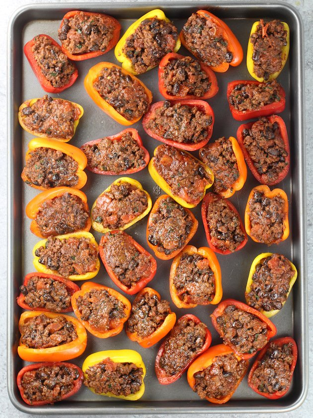 Stuffed peppers with meat on cookie sheet