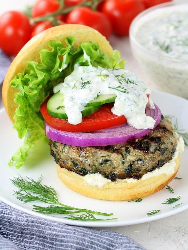 Greek Chicken Burger on Brioche Bun with Onion Tomato Cucumber Lettuce and Tzatziki Sauce