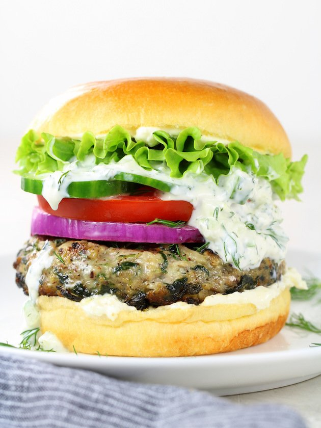 Chicken Burgers with Feta Cheese and Spinach on a bun, plated
