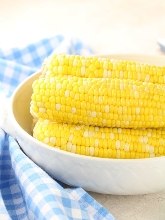 Eye level partial bowl of corn on the cob
