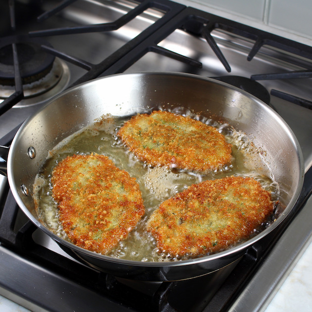 Breaded veal cutlets sauteed in fry pan