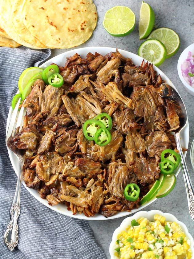 A plate of Pork Carnitas garnished with jalapenos