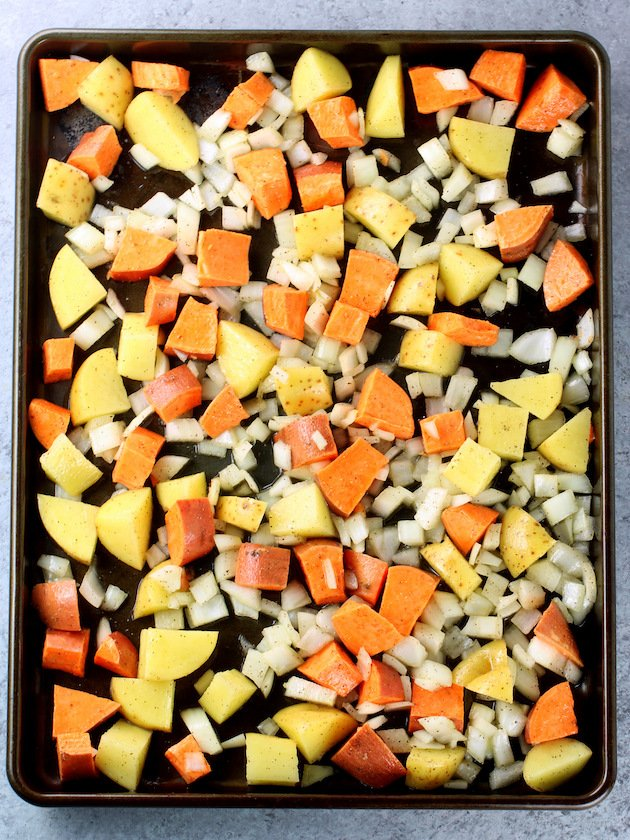Baking sheet with chopped root vegetables