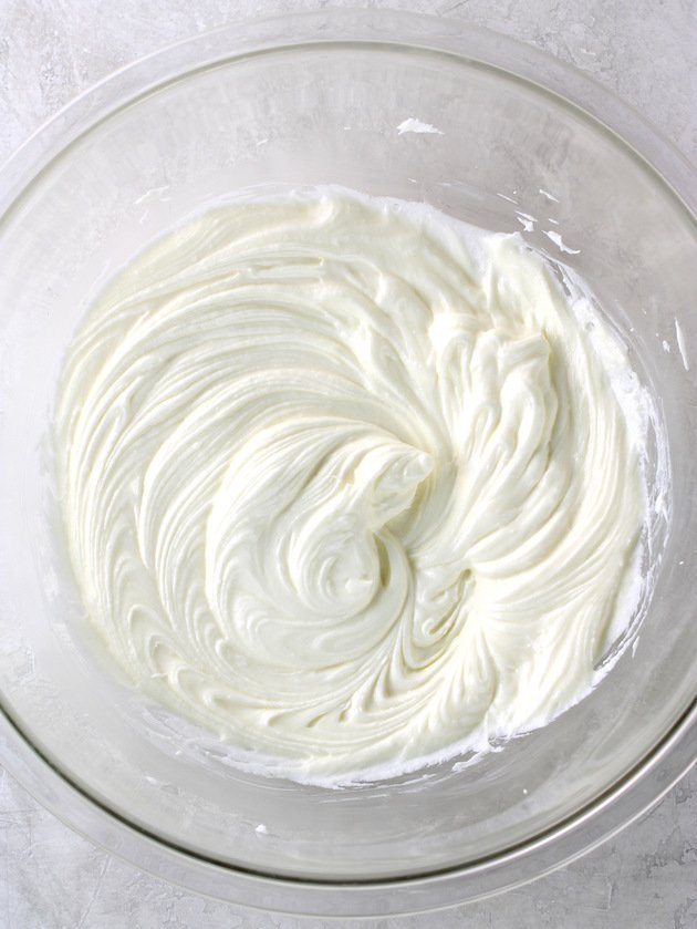 whipped cream cheese cake mix in a glass bowl