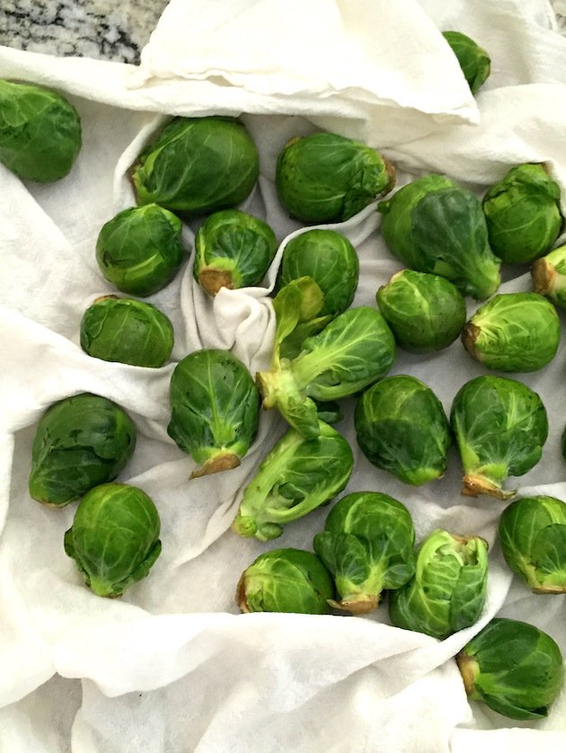 Fresh Brussels Sprouts drying on paper towels