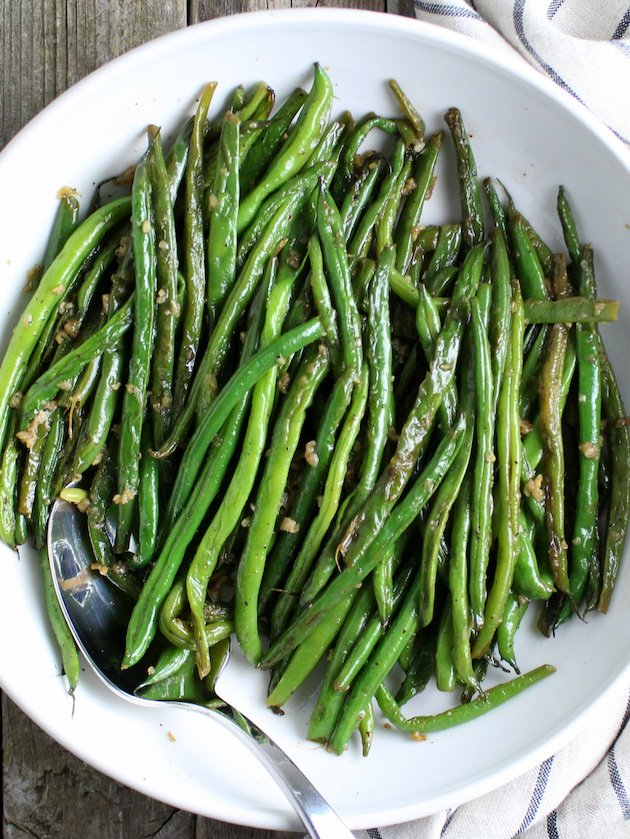 Garlic Green Beans in serving dish with spoon