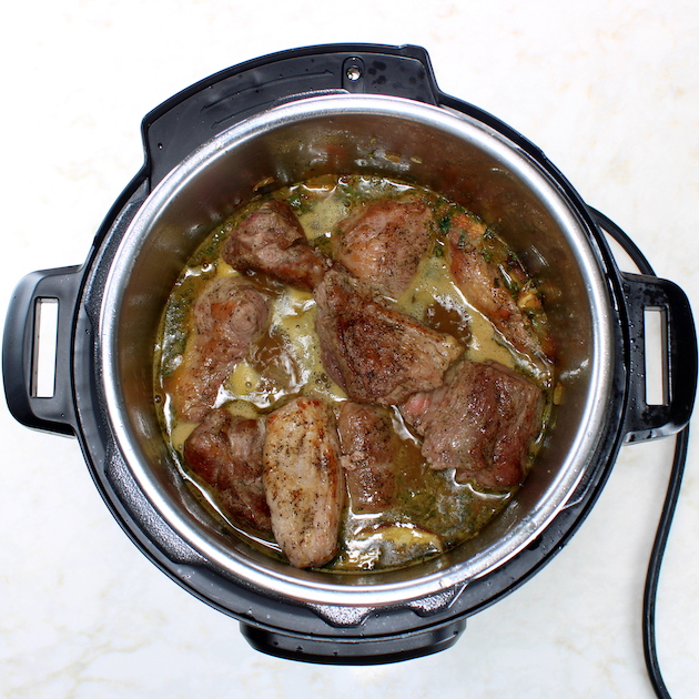 Instant pot with pork and vegetables cooking