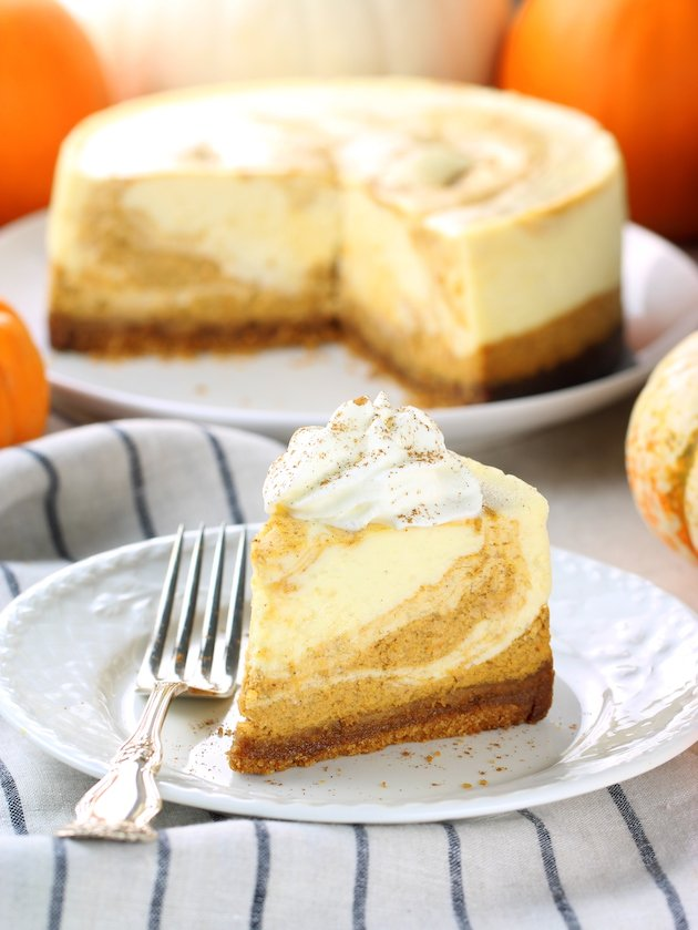 A piece of pumpkin cheesecake on a plate, with Cheesecake and Pumpkin