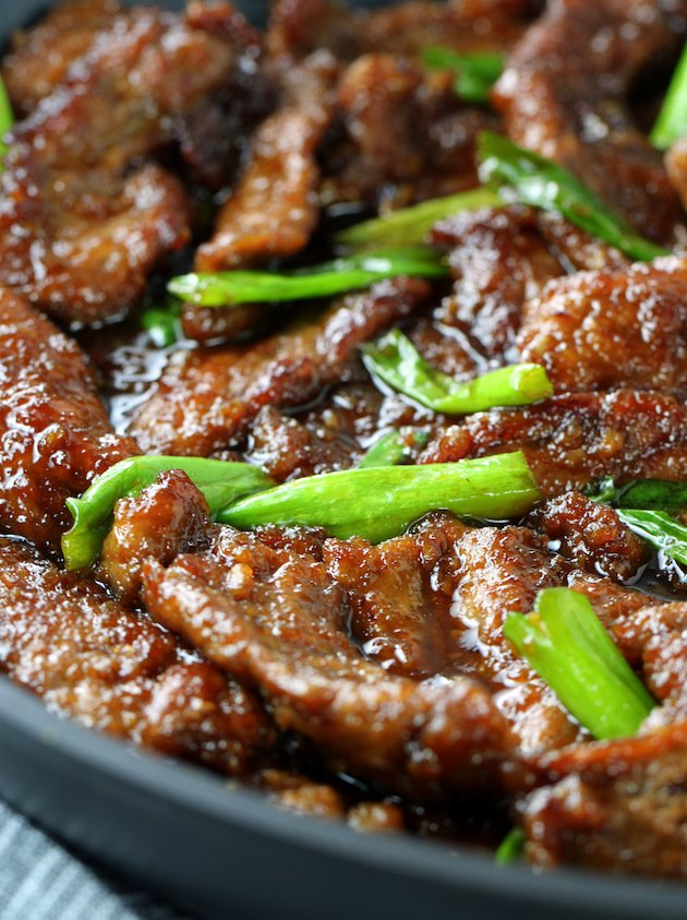 A close up of a plate of Mongolian beef