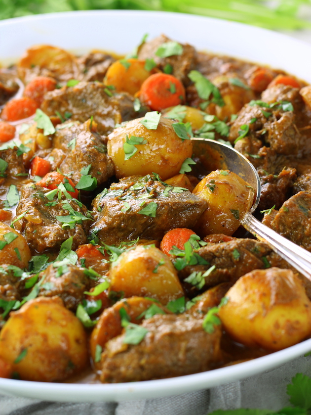 A bowl of food with Beef potatoes and Spices