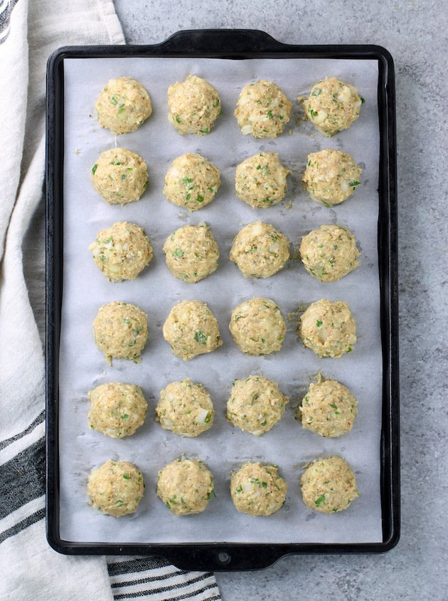 Chicken meatballs on parchment paper before baking