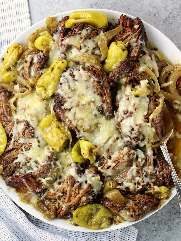 platter of Italian beef with onions and pepperoncini