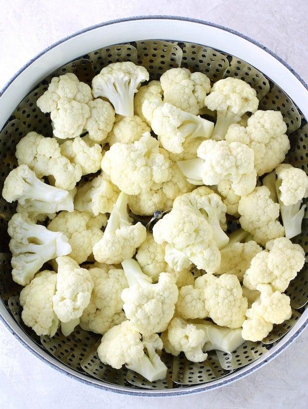 Cauliflower florets in steaming basket