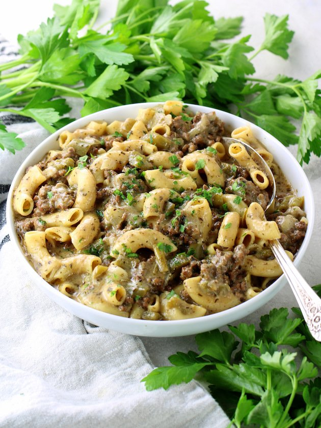 Instant Pot Philly Cheesesteak Pasta with spoon in bowl