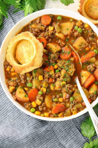 Bowl of Beef and vegetable Soup with a puff pastry shell