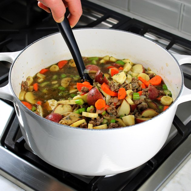 A large white pot of Beef soup