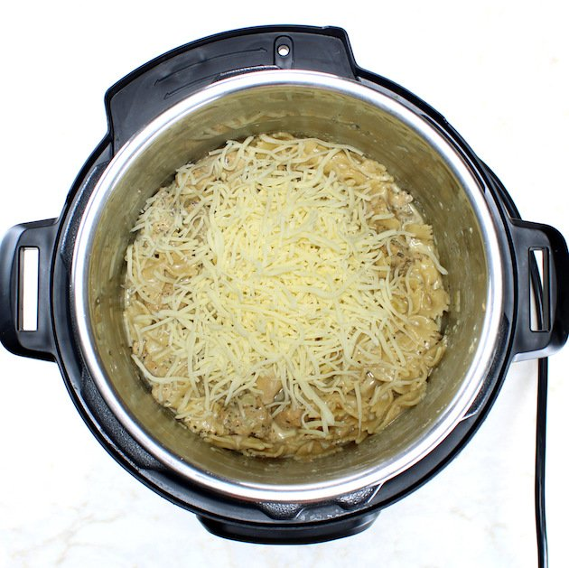 Adding shredded cheese to Instant Pot Chicken Florentine Pasta