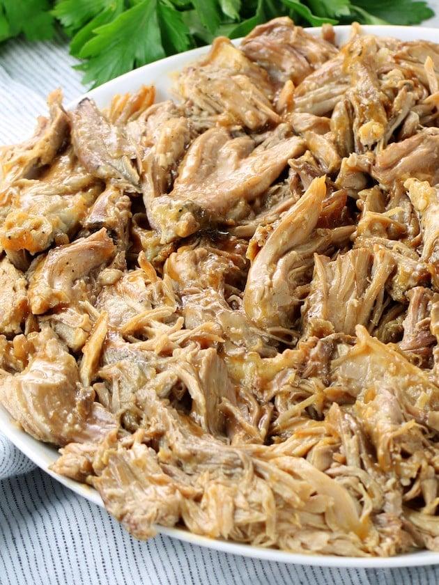 Close up shredded pork on a platter