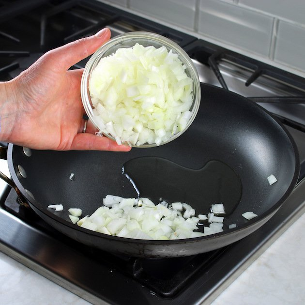 cooking onions in skillet for Million Dollar Spaghetti