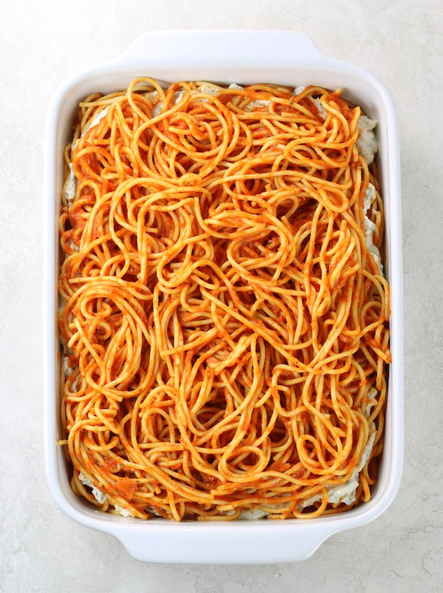 Baking dish with layers of spaghetti casserole