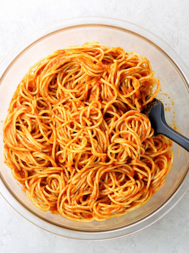 A bowl of pasta with red sauce