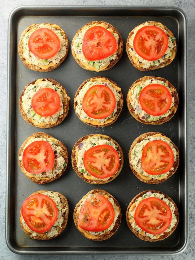 Tuna Melts with tomatoes on a baking sheet