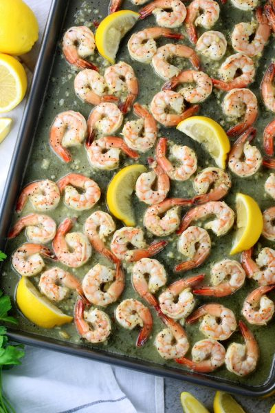 Lemon pepper shrimp on a baking sheet
