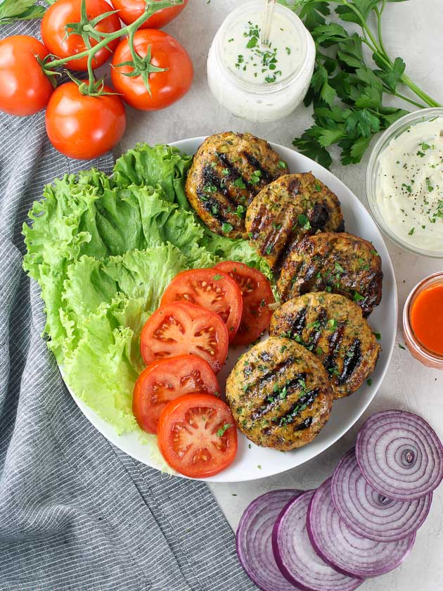 Platter of grilled Buffalo Chicken Burgers with sides