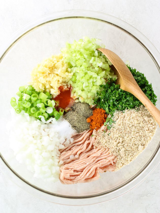Ingredients to make buffalo chicken burgers in a glass bowl