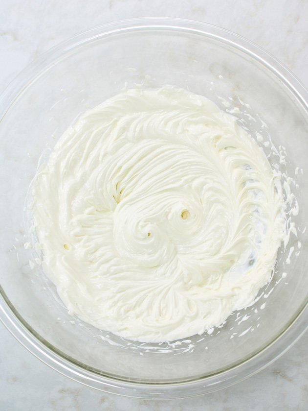 cream cheese whipped in large glass bowl