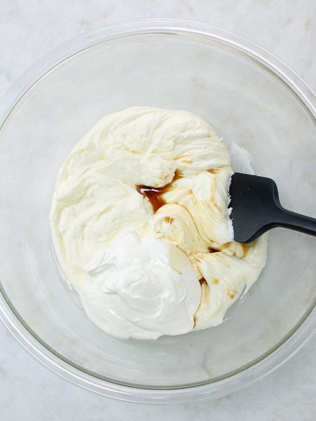 adding vanilla to bowl of whipped fillings