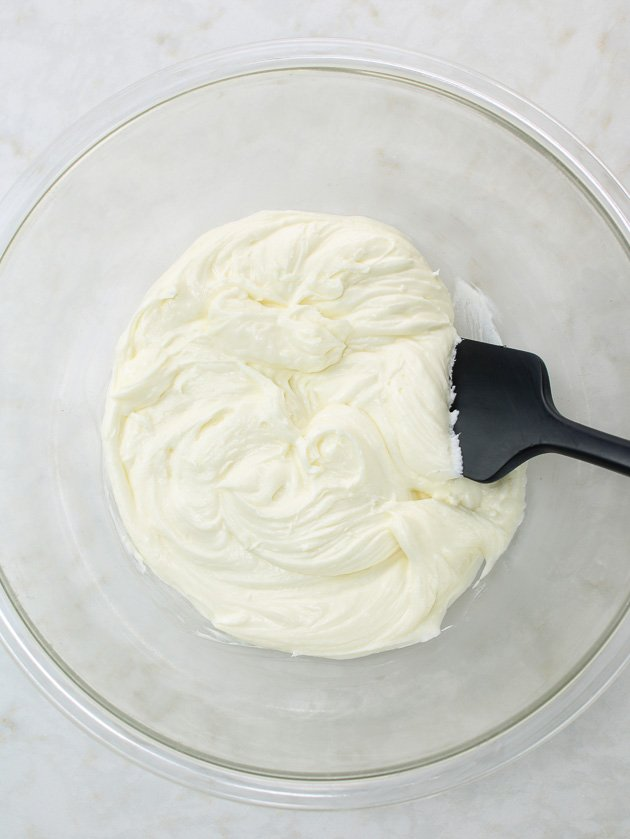 spatula in glass bowl of whipped cream cheese