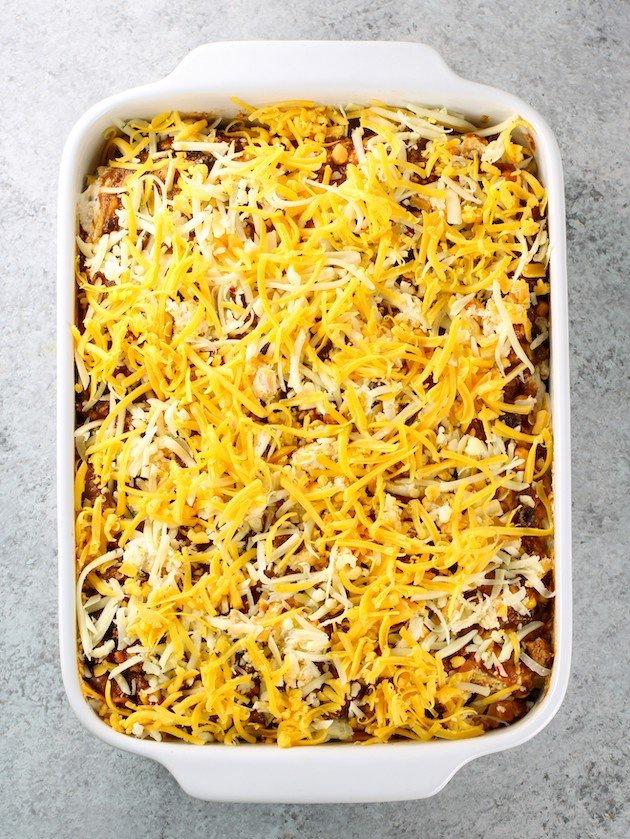 Mexican Lasagna in casserole dish before cooking