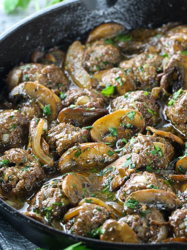 Meatballs and mushrooms in skillet