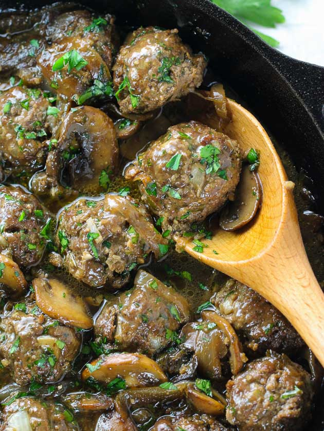 close up skillet of salisbury steak meatballs