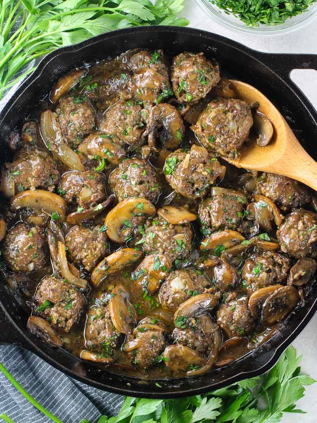A pan filled with meat and vegetables, with Salisbury steak Meatballs