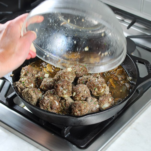 adding meatballs to skillet