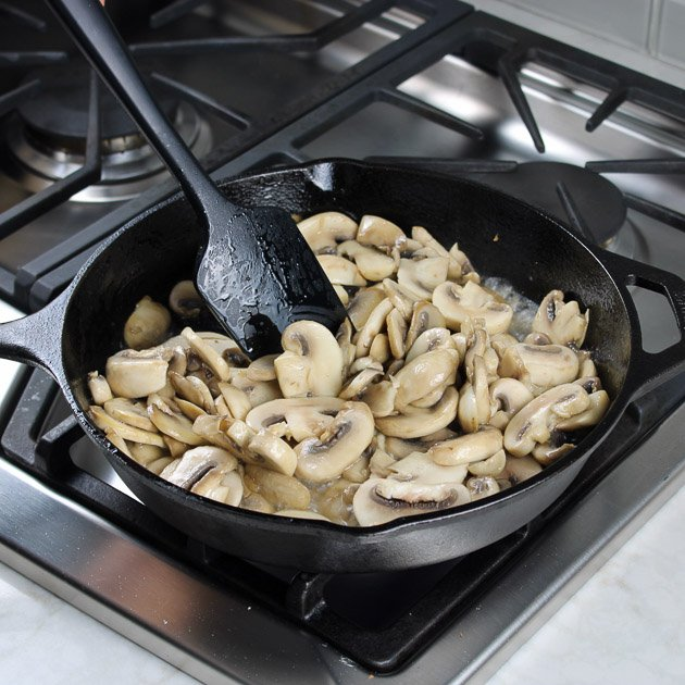sauteeing mushrooms in pan