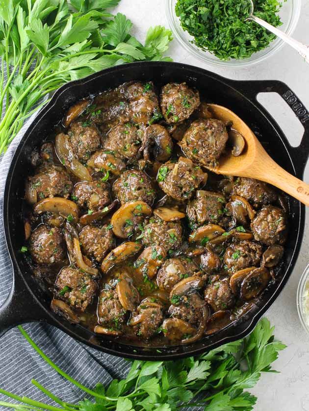 A skillet full of Meatballs and Salisbury steak