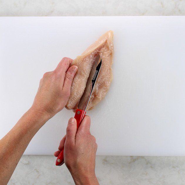 Cutting raw chicken