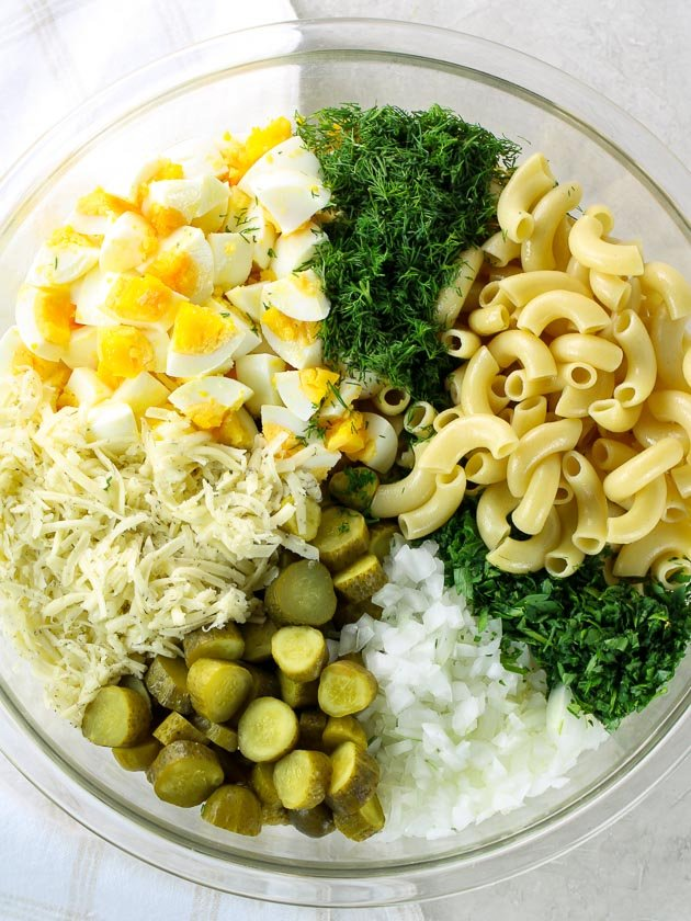 Ingredients for Macaroni salad in a bowl before combining
