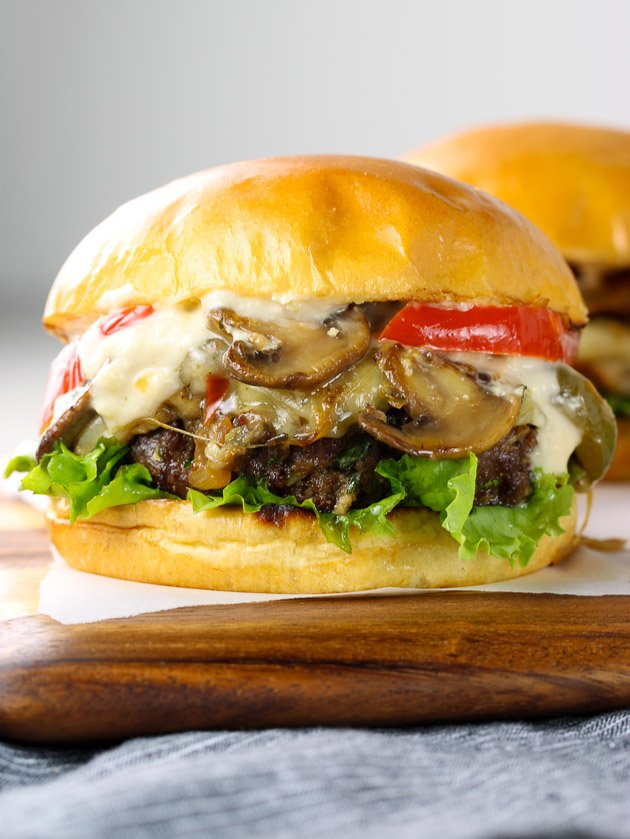 Philly Cheesesteak Burger on a cutting board