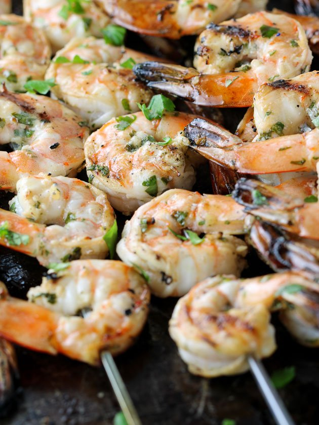 A group of grilled shrimp on skewers