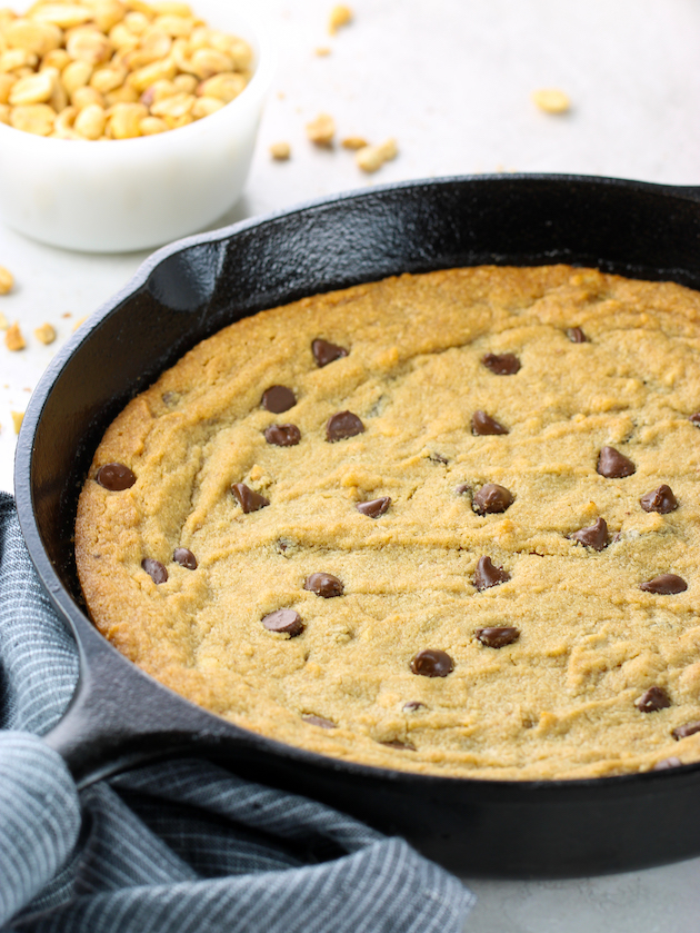 Close up partial skillet with peanut butter chocolate chip cookie
