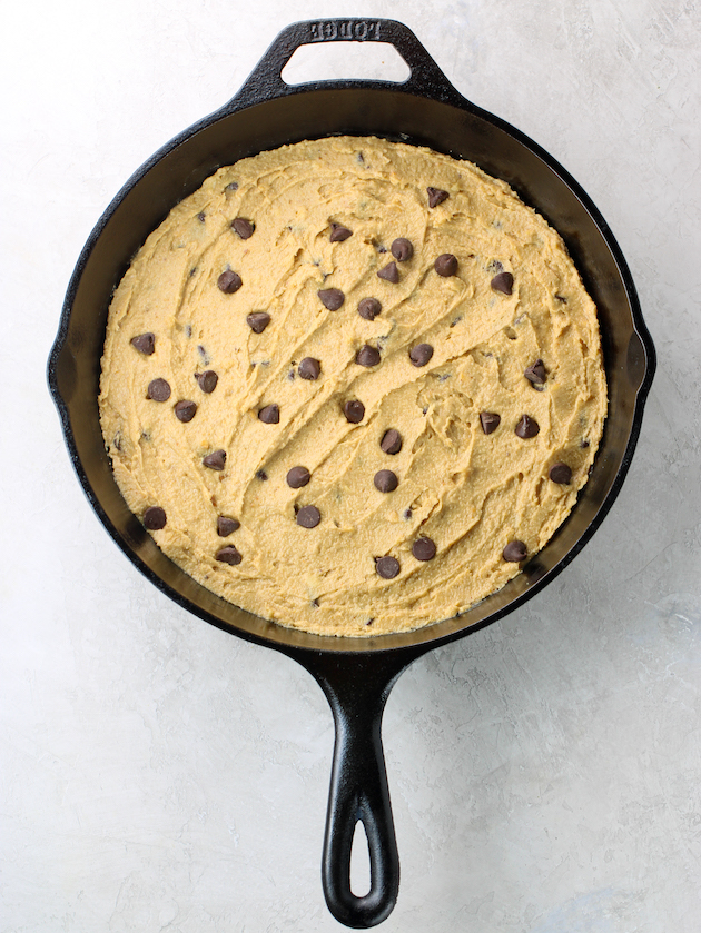 Cookie dough in cast iron skillet before baking