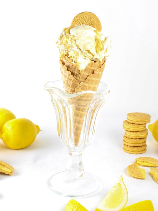 Eye level lemon ice cream cone in a glass sundae dish