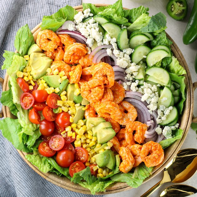 fresh veggie salad with buffalo shrimp