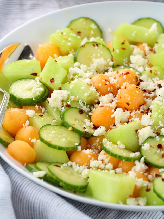 Eye level partial platter with cucumber melon salad