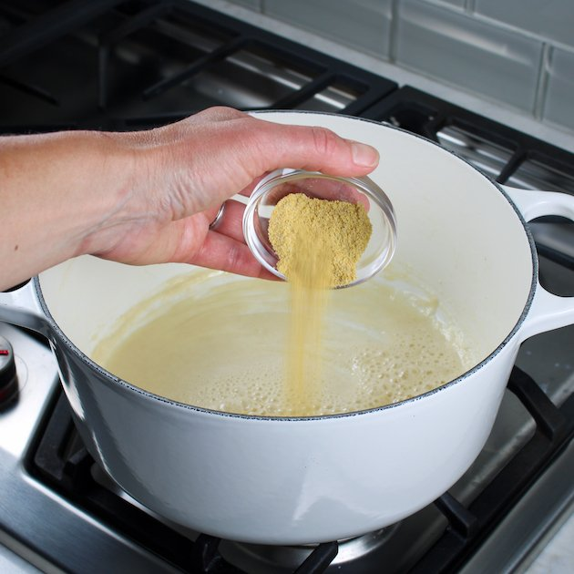 Adding dry mustard to a pot